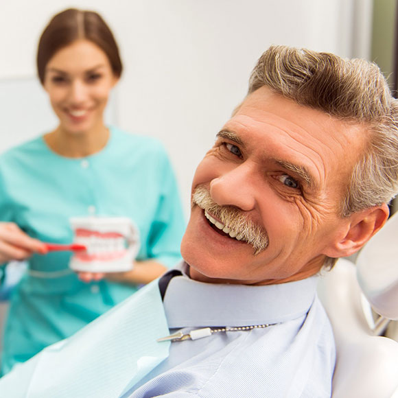 man with mustache and dentures